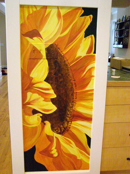 hand painted mural of large sunflower in a kitchen by Boulder Murals
