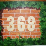 hand painted mural of Wrigley Field in a bedroom by Boulder Murals