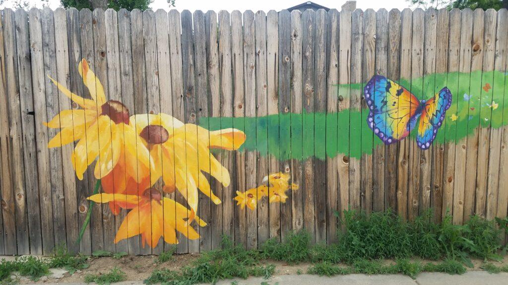 Black eyed susan flower mural on fence