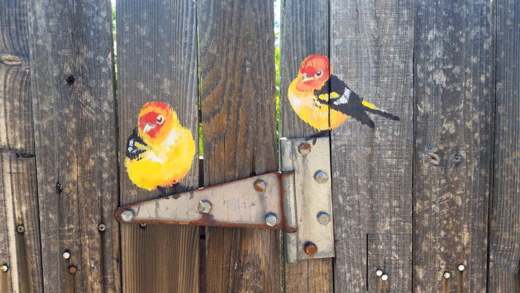 mural birds on fence