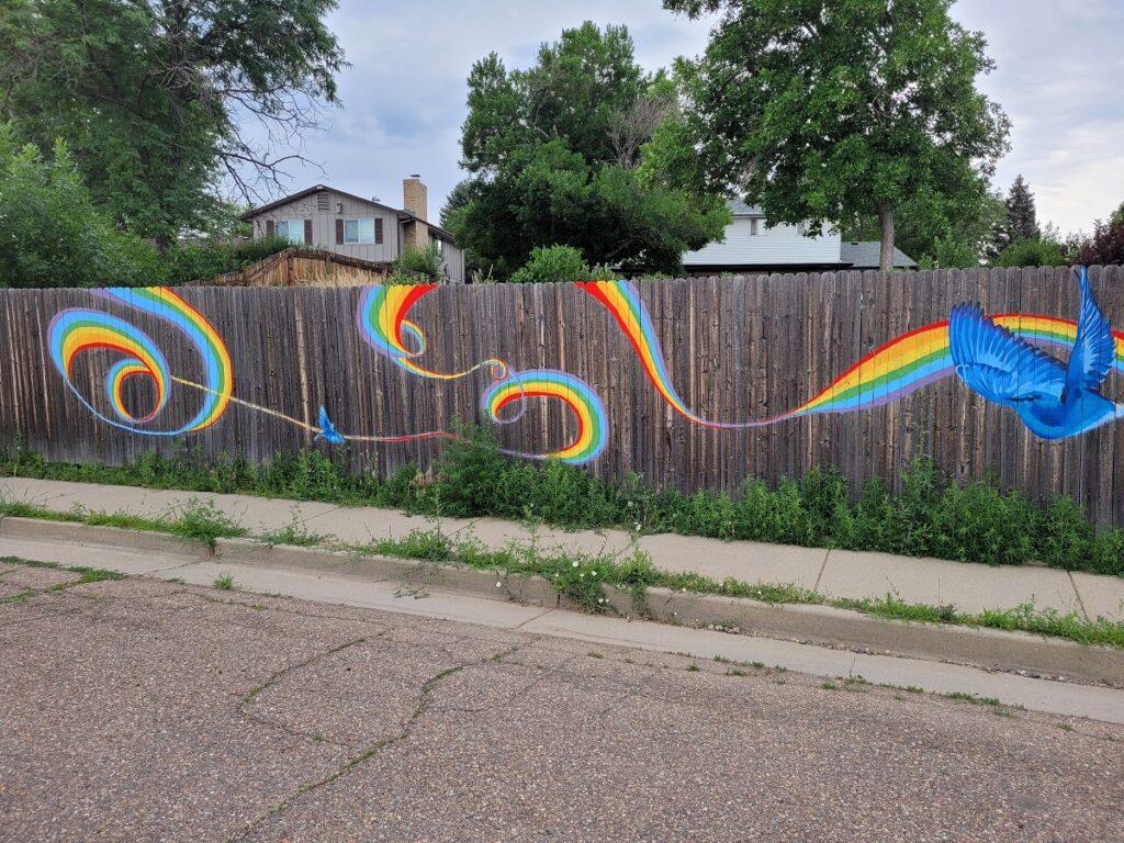 Rainbow mural on fence